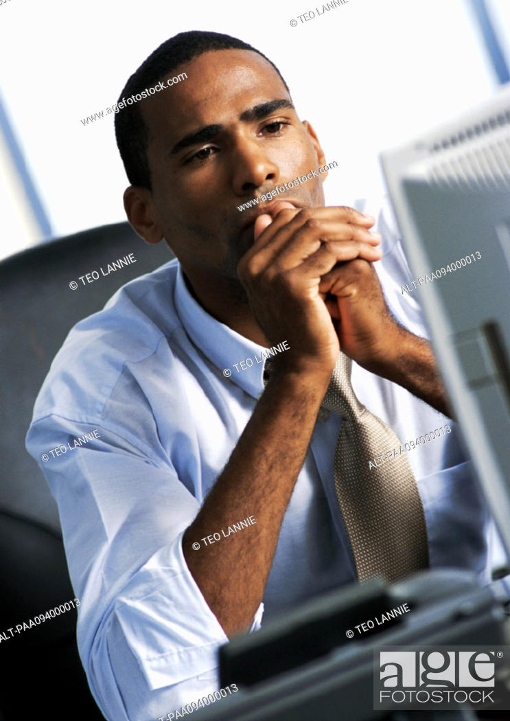 Stock Photo: Businessman looking at computer.
