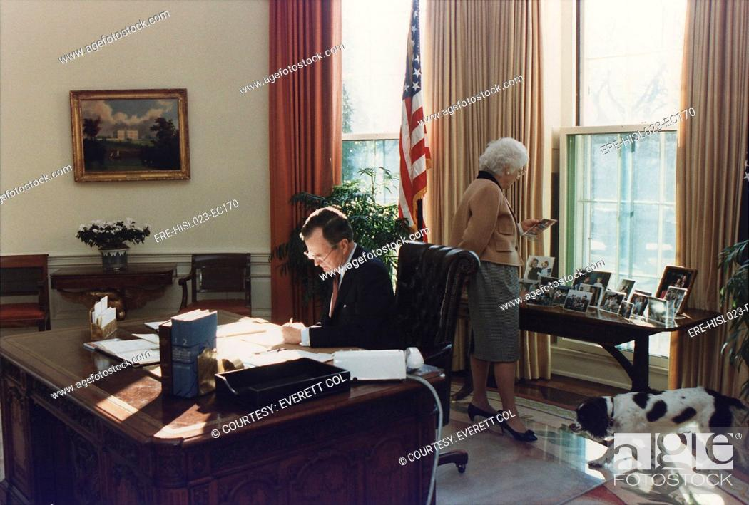 george bush oval office. Stock Photo - During His First Week As President George Bush Works In The Oval  Office Wife Barbara Looks At Photographs Behind Desk. Jan. 27 1989 George Bush Oval Office R
