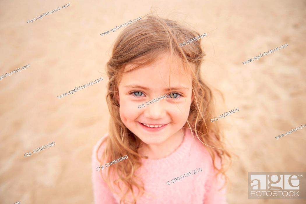 Stock Photo: Little girl smiling on beach.