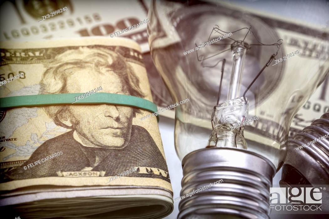 Stock Photo: A lightbulb on dollar bill, energy saving concept.