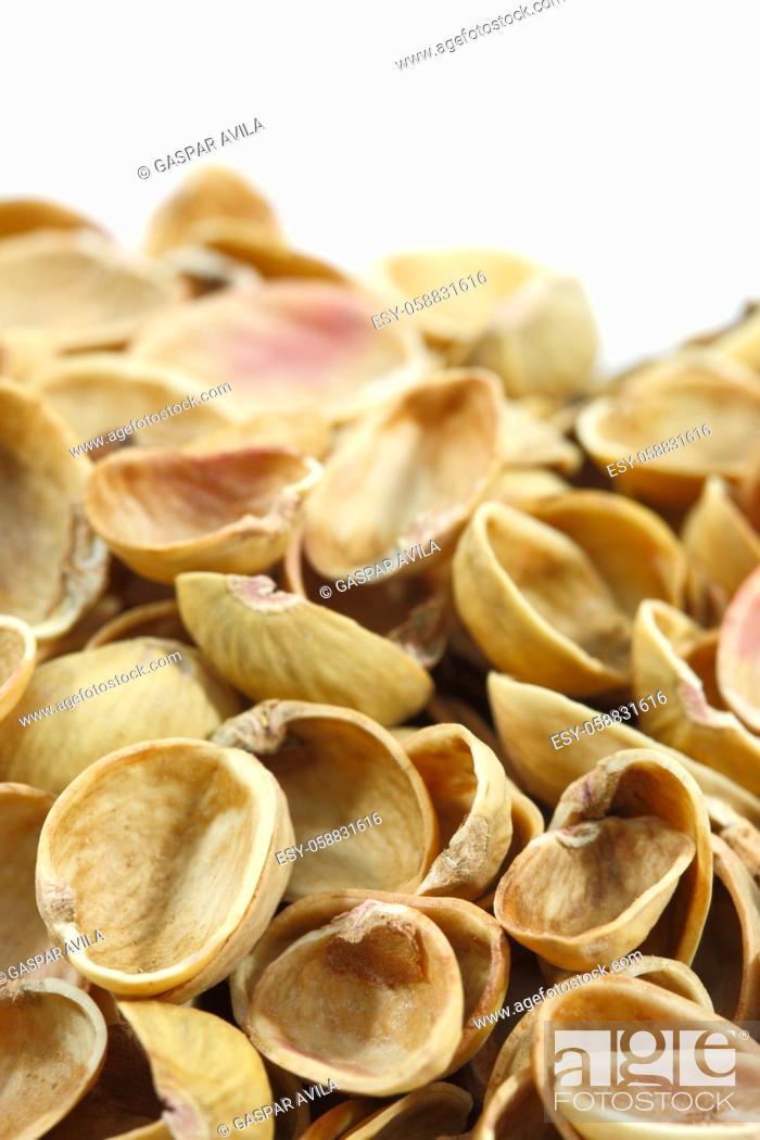 Stock Photo: Empty pistachios shells.