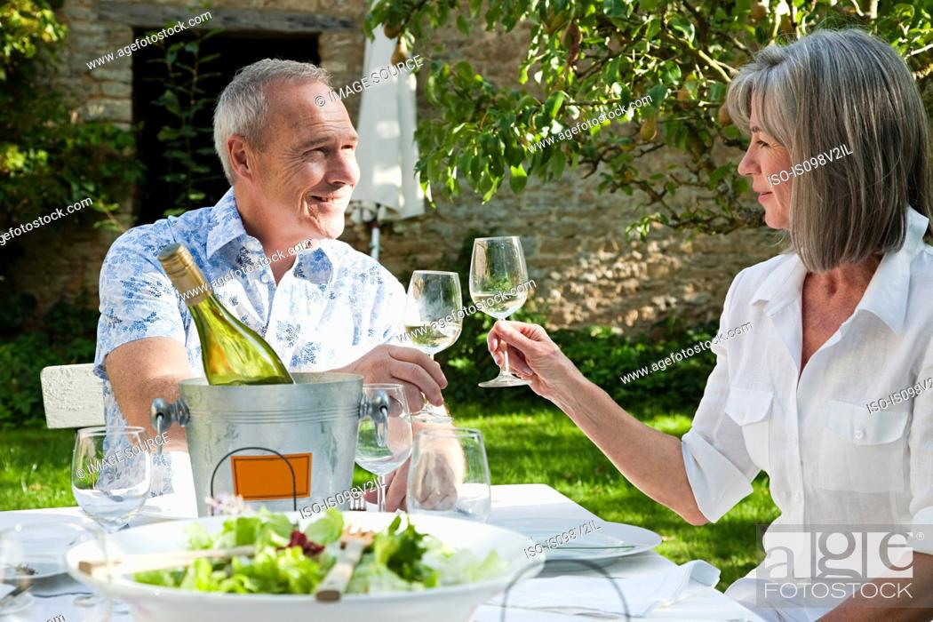 Stock Photo: Mature couple having lunch outdoors.