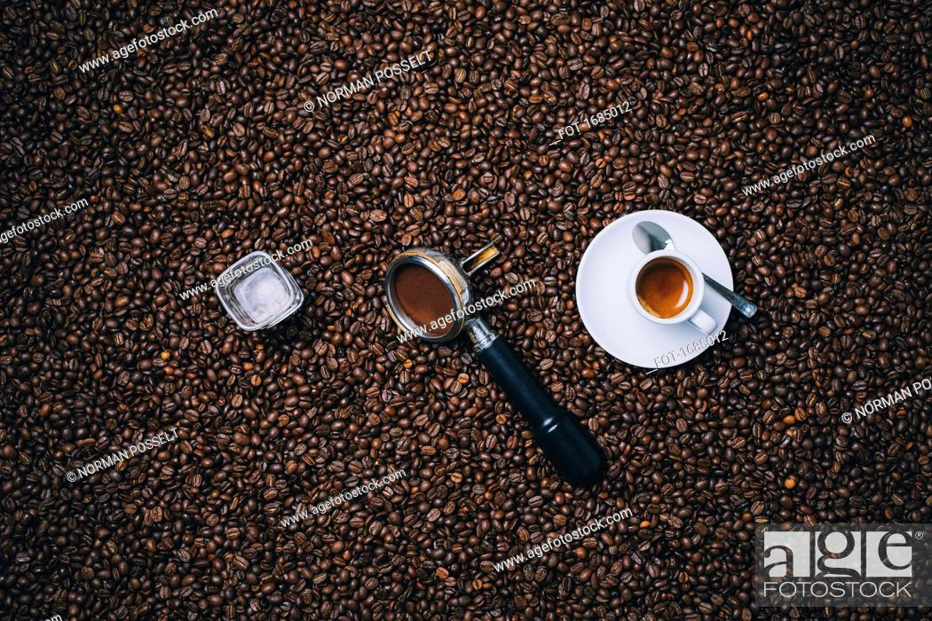Stock Photo: Directly above shot of espresso cup with filter and glass on roasted coffee beans.
