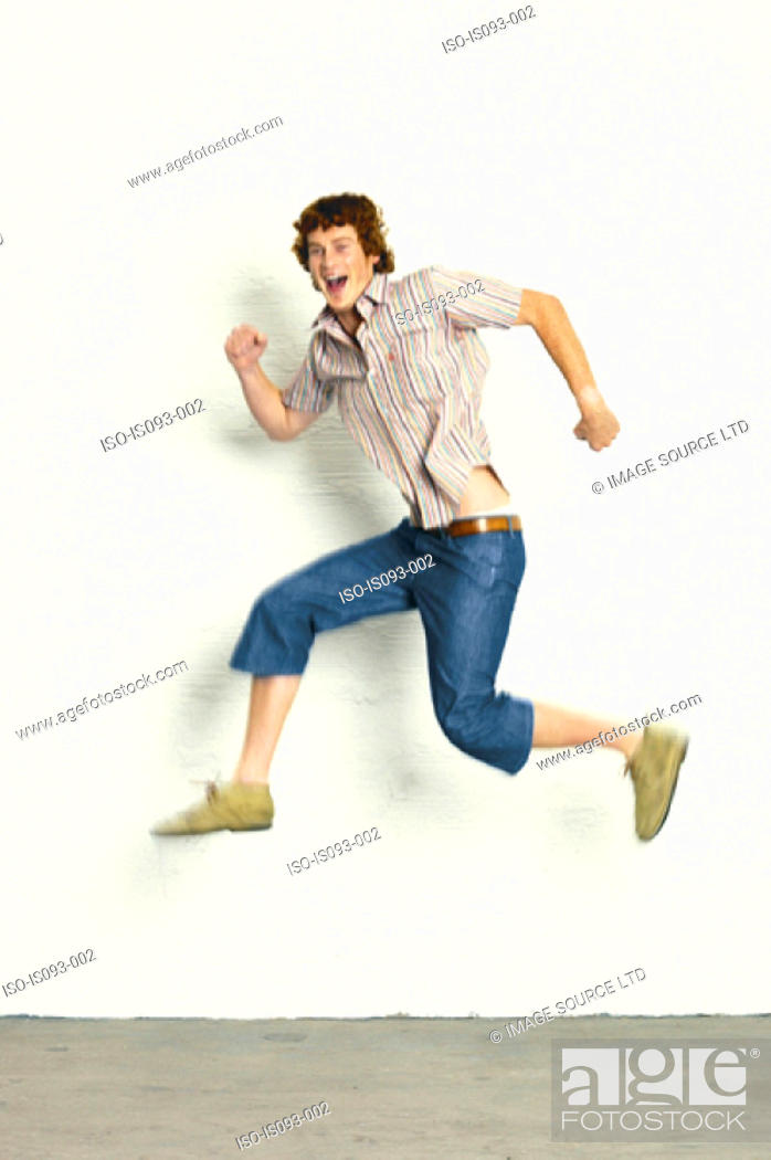 Stock Photo: Man jumping in the air.
