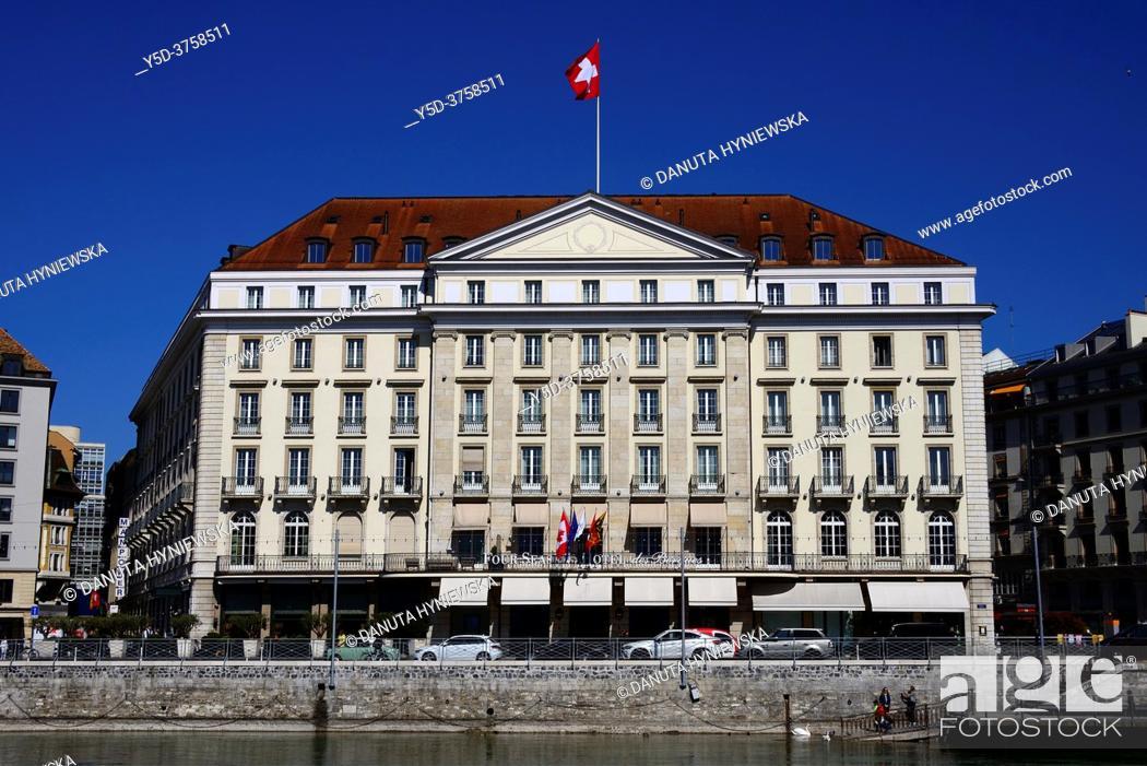 Stock Photo: Quai des Bergues along Rhone river, Five-star luxury historic Four Seasons Hotel des Bergues Geneva, Geneva, Switzerland, Europe.