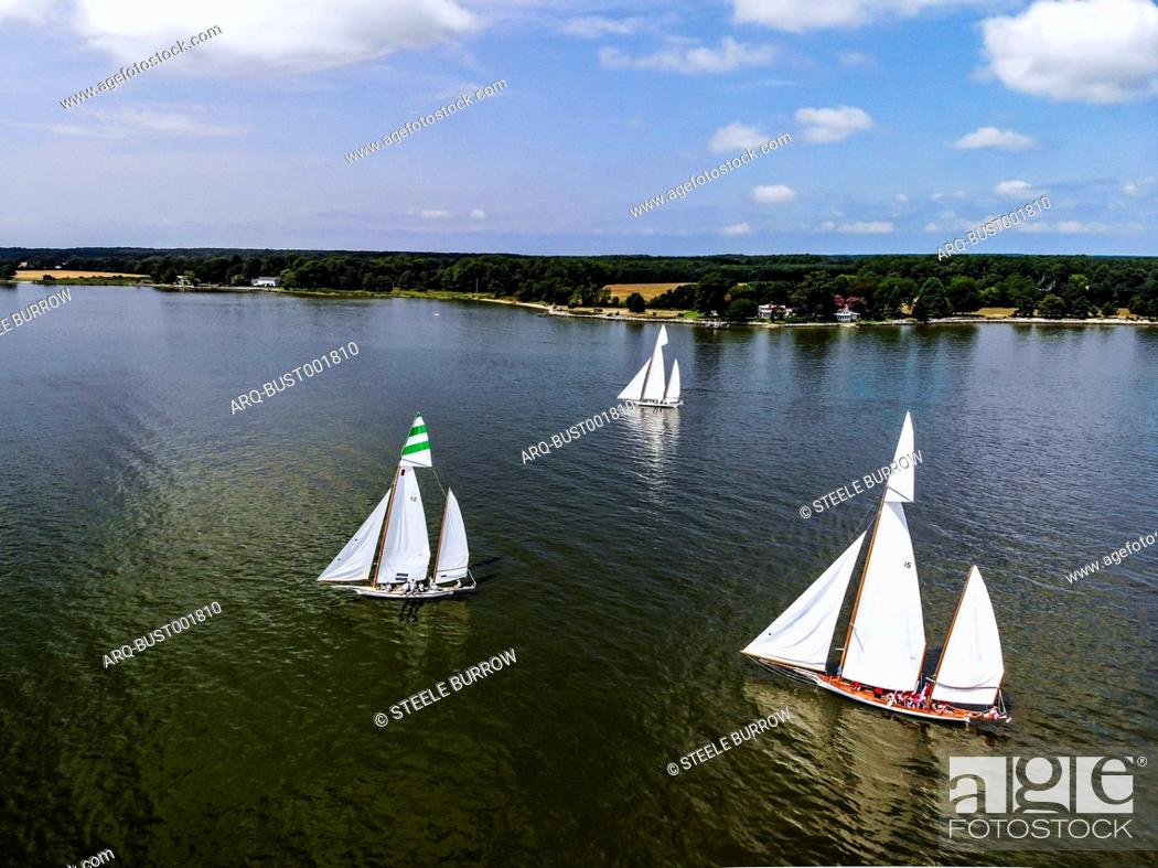 Stock Photo: Sailboats participate in a sailing regatta on the Eastern Shore of Maryland during a warm summer day. Located several hours from Washington, DC.