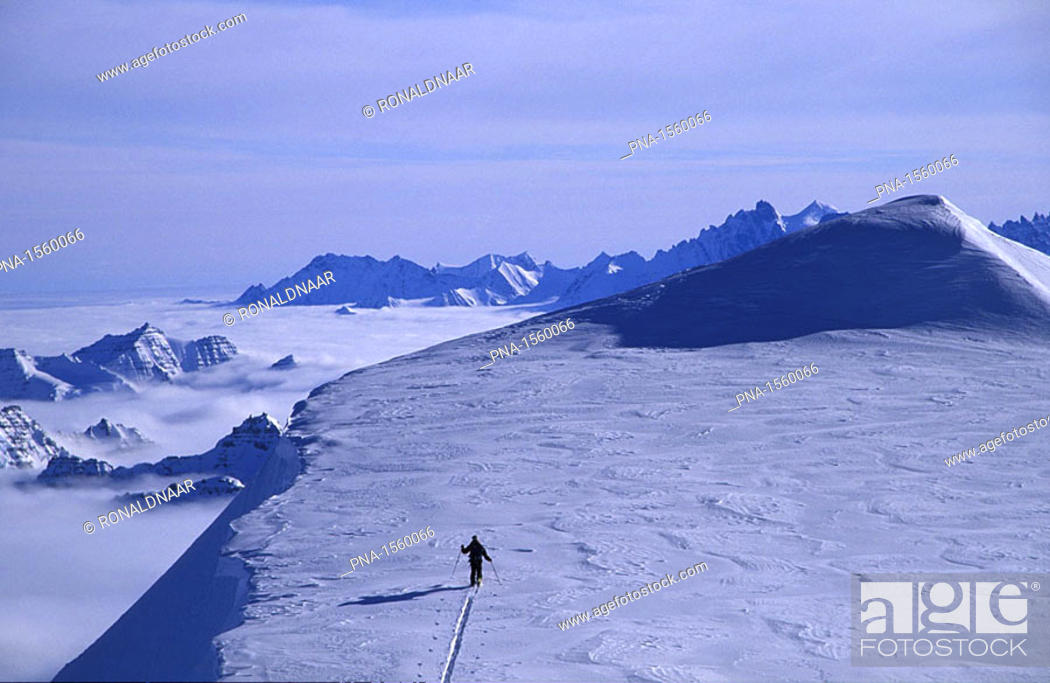 Stock Photo: Dutch mountaineer Ronald Naar ascending the last meters of an unclimbed peak in the mountains of eastern Greenland.