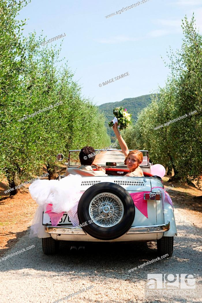 Stock Photo: Newlyweds in classic car.