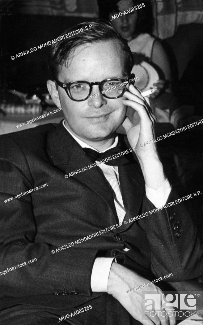 Stock Photo: Truman Capote sitting in the restaurant of the M/S Vulcania. American writer and journalist Truman Capote sitting in the dining area of the M/S 'Vulcania'.