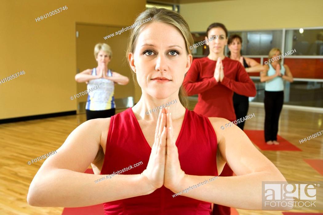 Stock Photo: Prime adult female Caucasians in yoga class.