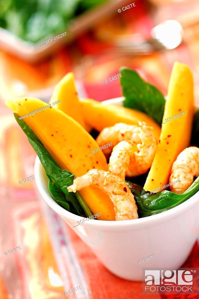 Stock Photo: mango, prawn and spinach salad.