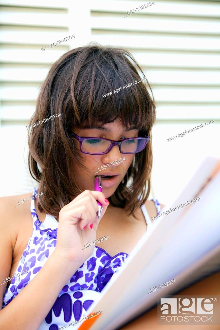 Stock Photo: Teenager doing homework.