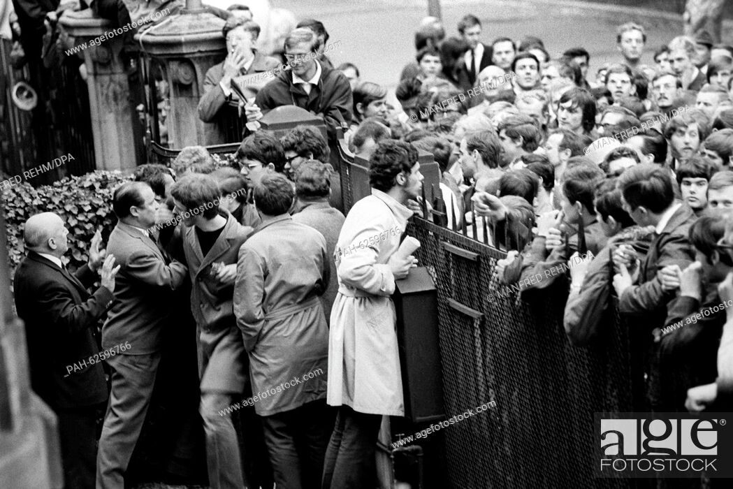Stock Photo: Students from Frankfurt try to enter the garden of the French consulate general on 06 May 1968. About 1, 500 students gathered in front of the consulate to.