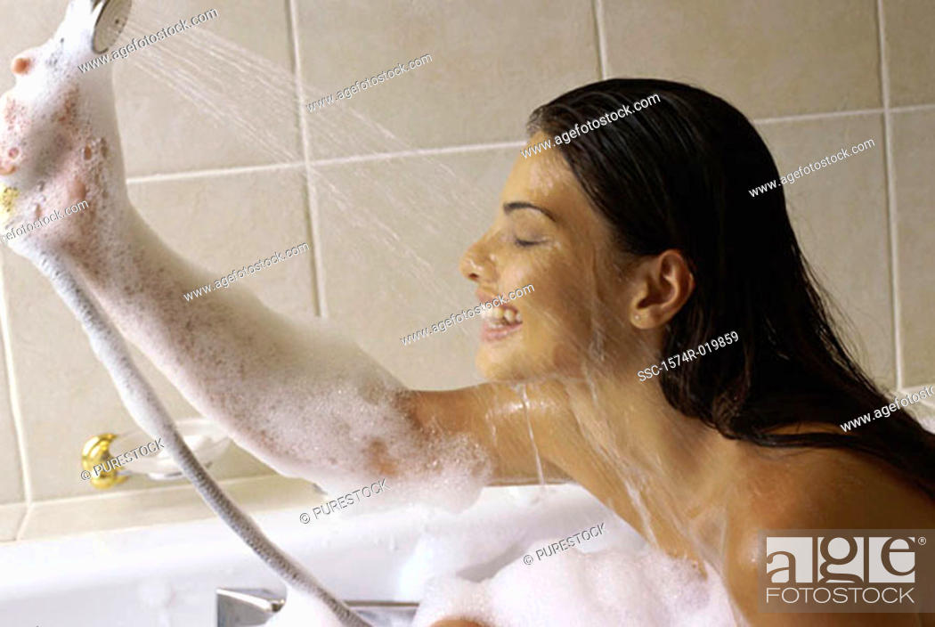 Stock Photo: Young woman taking a bubble bath.