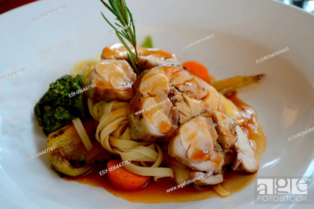 Stock Photo: delicious cooked rabbit meat with noodles and vegetables.