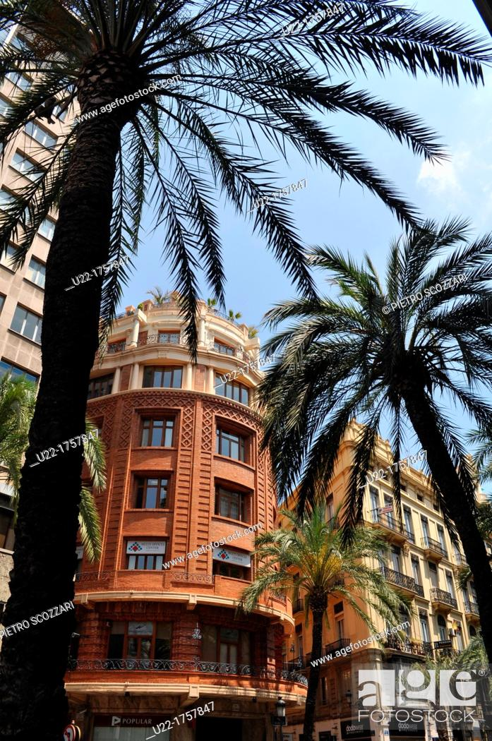 Stock Photo: Valencia, Spain: buildings and palms along Calle de las Barcas.