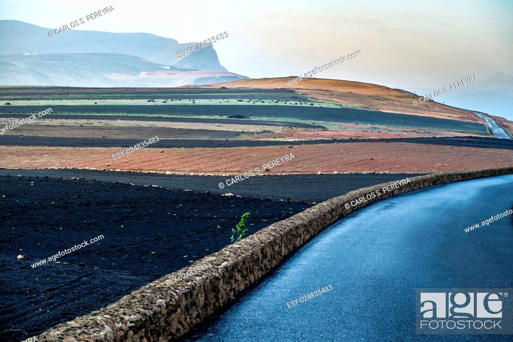Stock Photo: Road in the volcanic area of Lanzarote, Canary Islands, Spain.