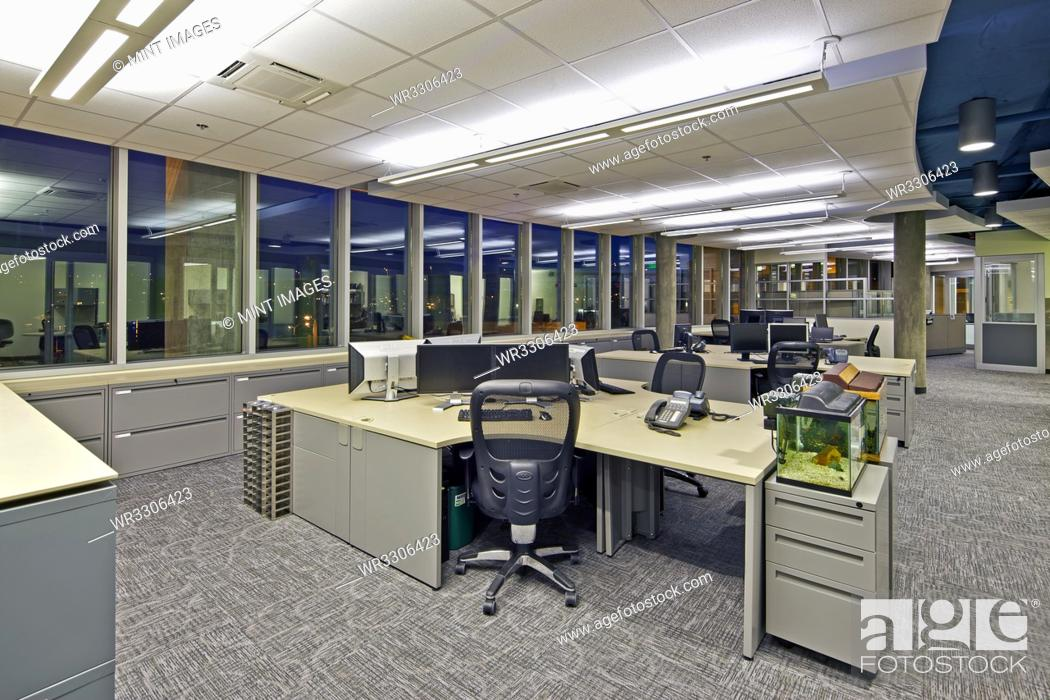 Stock Photo: Vacant office at night.