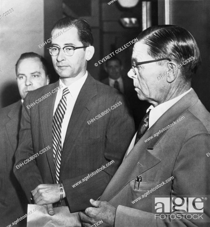 Stock Photo: Dr. Albert Blumberg, an accused and admitted Communist, in handcuffs, Oct. 20, 1954. In 1956 he was convicted under a provision of the 1940 Smith Act.
