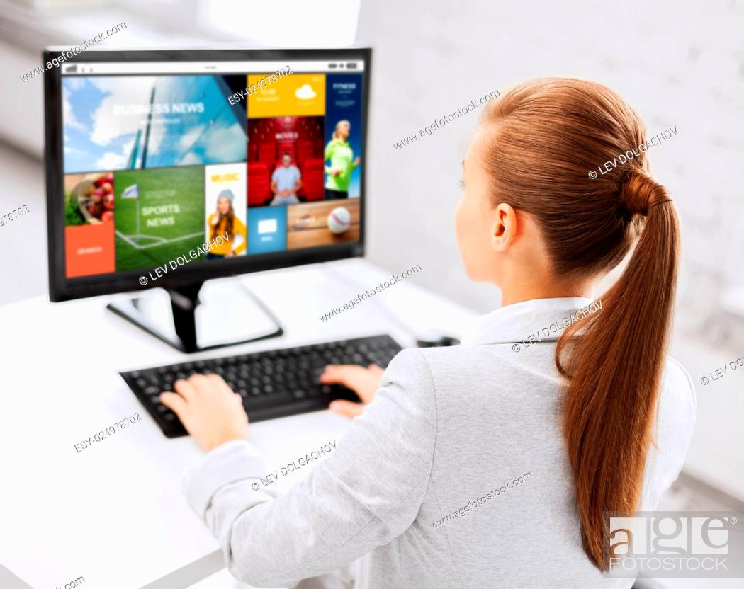 Stock Photo: business, people, technology, media and education concept - businesswoman or student girl with internet page on computer screen sitting at office table.