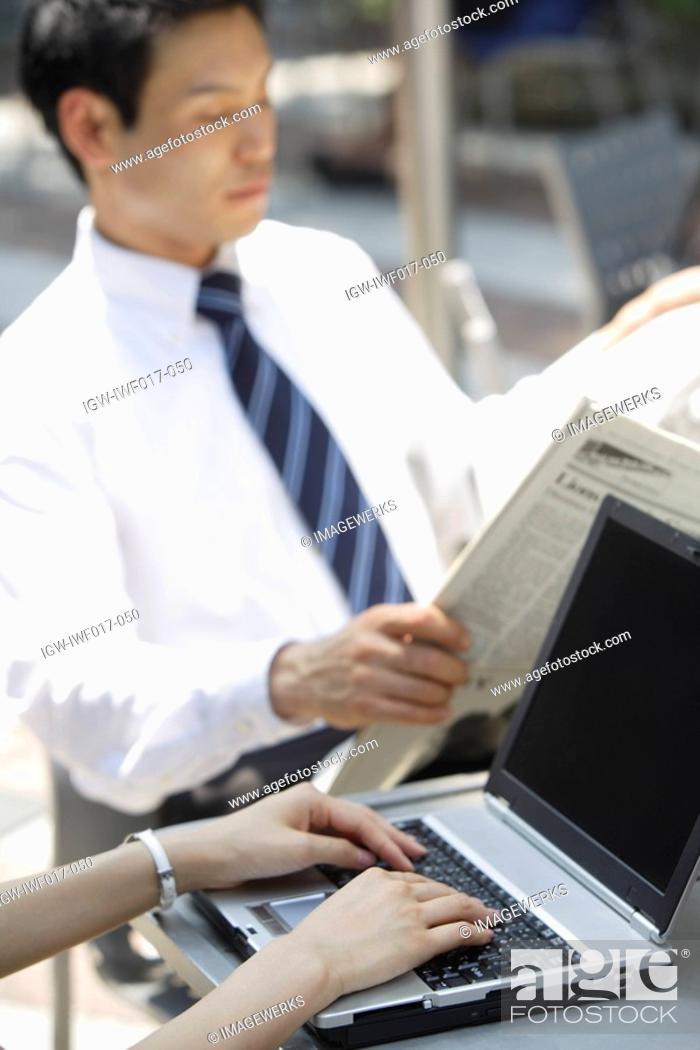 Stock Photo: Businessman reading newspaper, portrait.
