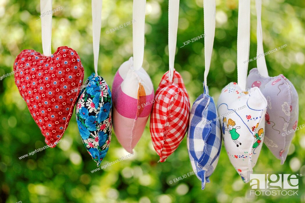 Stock Photo: Homemade heart clothes hanging.