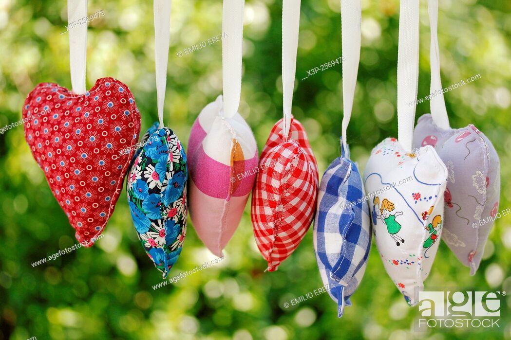 Imagen: Homemade heart clothes hanging.