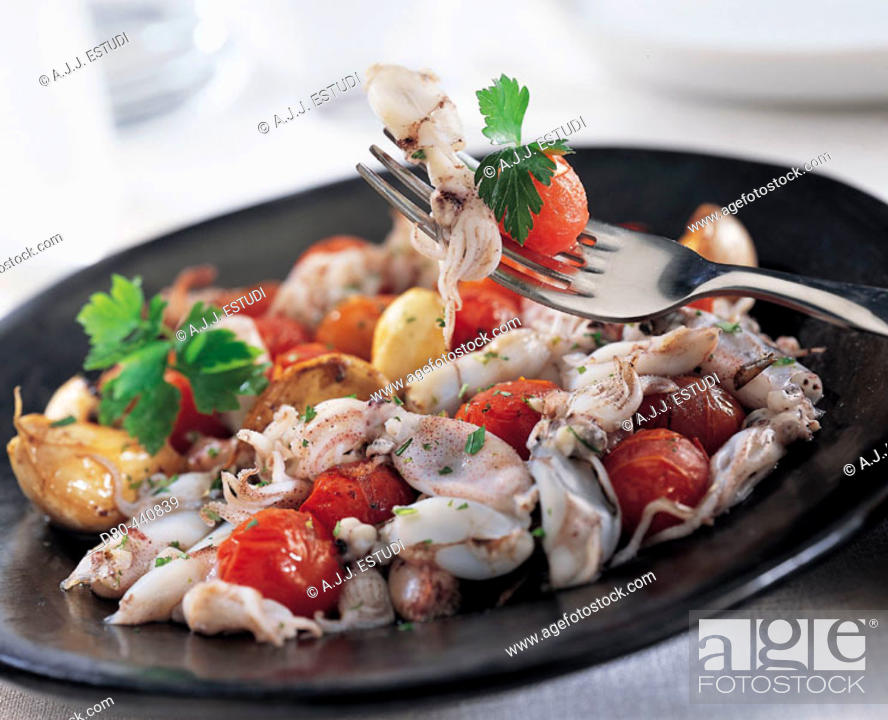 Stock Photo: Provençal style stir fry of small cuttlefish.