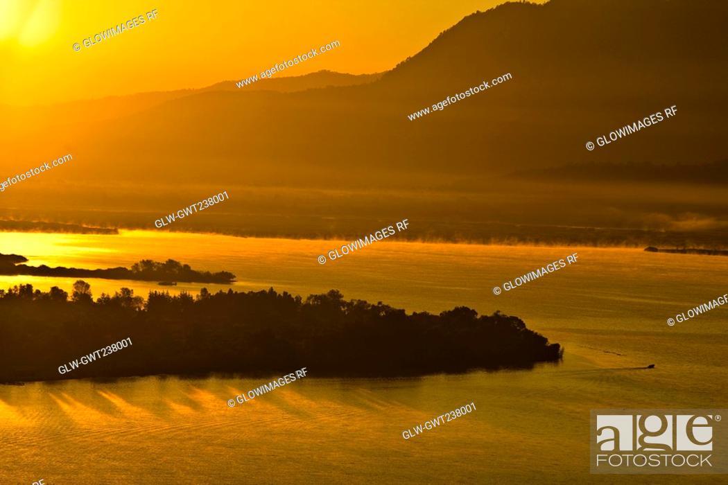 Stock Photo: Panoramic view of a lake at dusk, Janitzio Island, Lake Patzcuaro, Morelia, Michoacan State, Mexico.