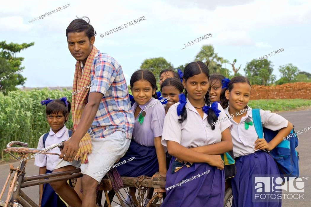 Stock Photo: indian young female students pose for a shoot on a bycicle pulled cart in dhapa district  kolkata  west bengal  india  asia.