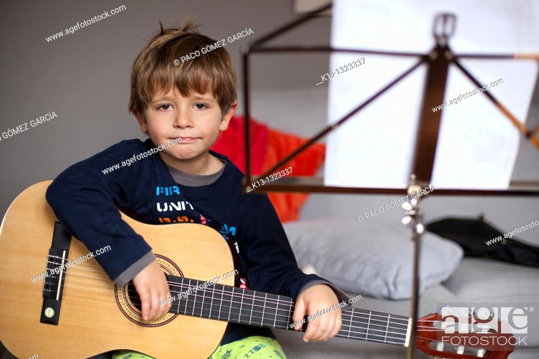 Stock Photo: Child rehearsing with guitar.