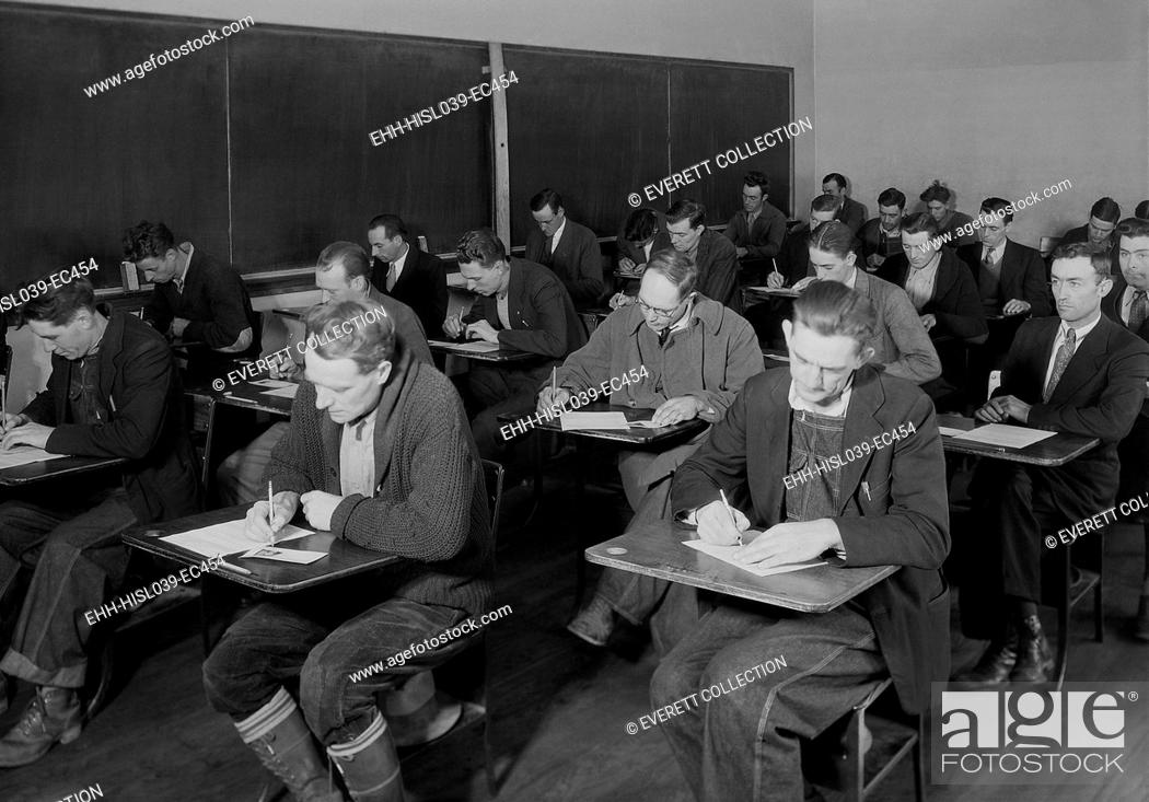 Stock Photo: Skilled and unskilled laborers taking the TVA examination, Clinton, Tennessee. Nov. 1933. The Tennessee Valley Authority began hiring workers in late 1933.