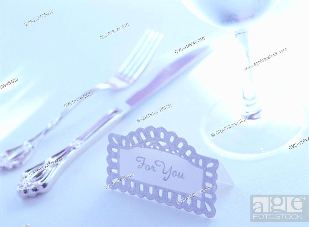 Stock Photo: Close Up of a Knife and Fork and Wineglass.