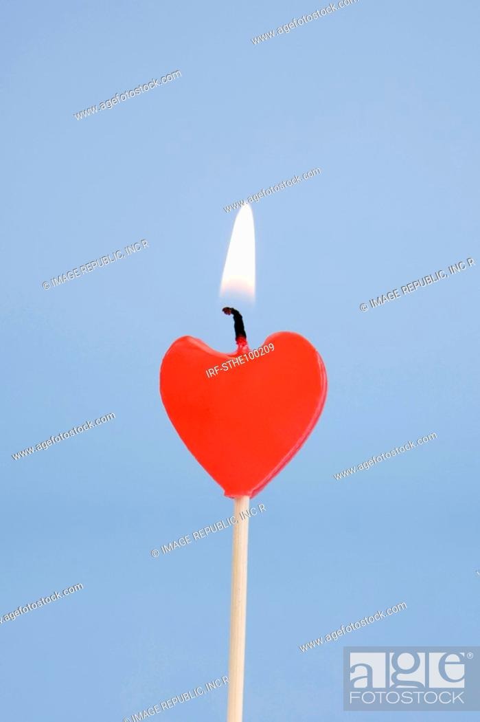 Stock Photo: heart shape candle.