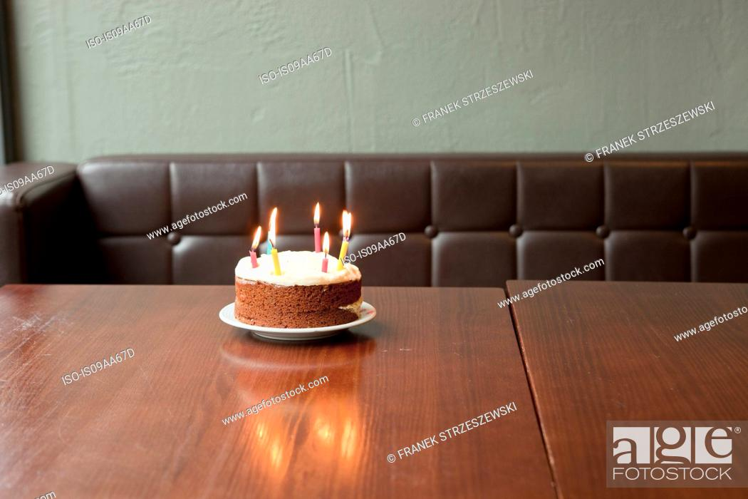 Birthday Cake On Table In Restaurant Stock Photo Picture And