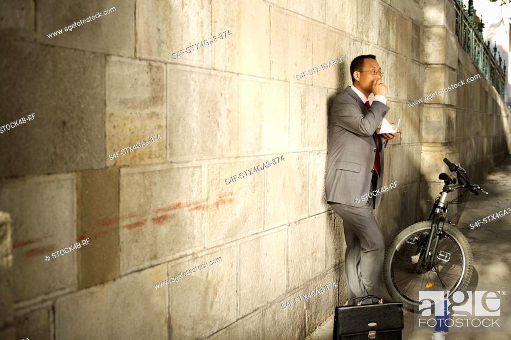 Stock Photo: Businessman taking a brake outsides.