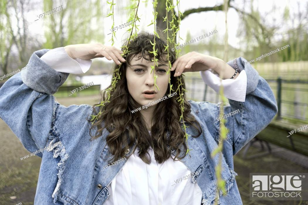 Stock Photo: Young woman in park, Berlin, Germany.