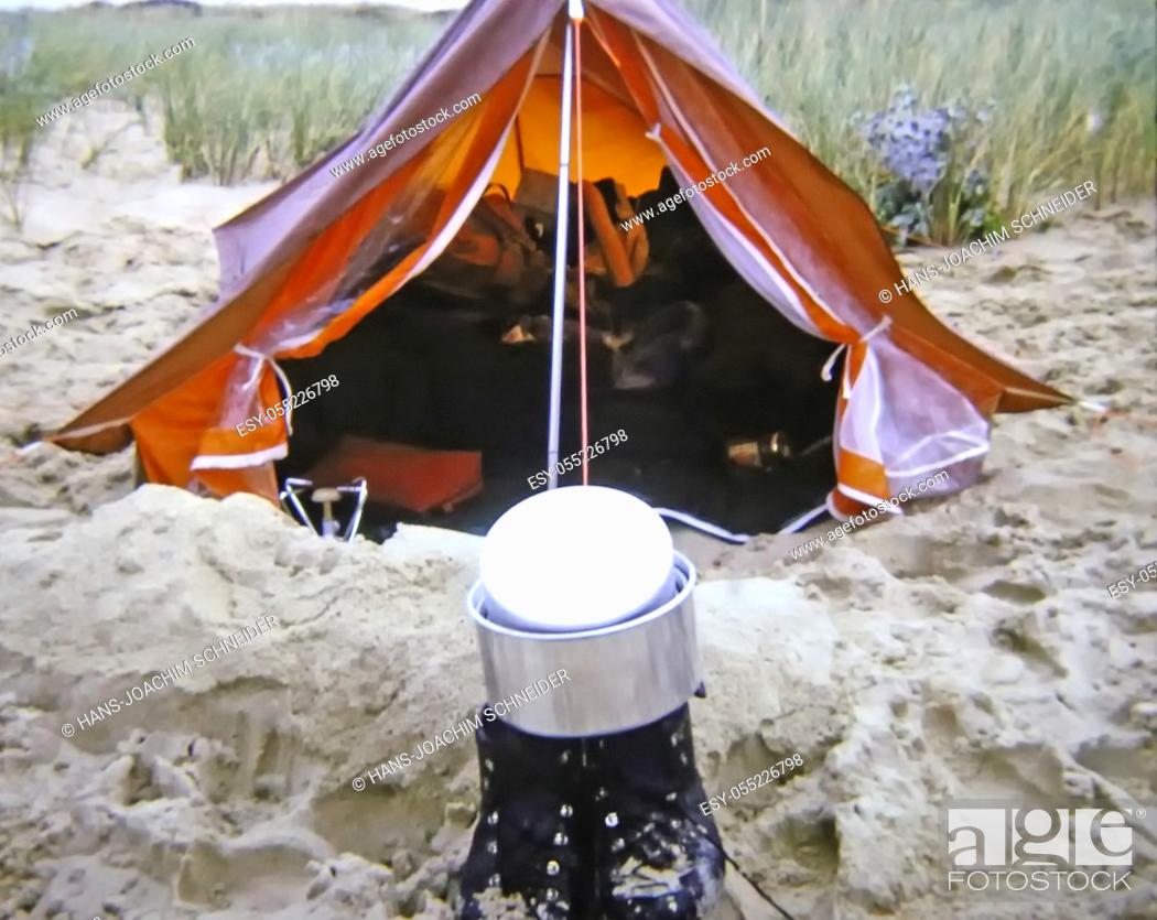 Stock Photo: small tent at a beach with shoes and cooking pot.