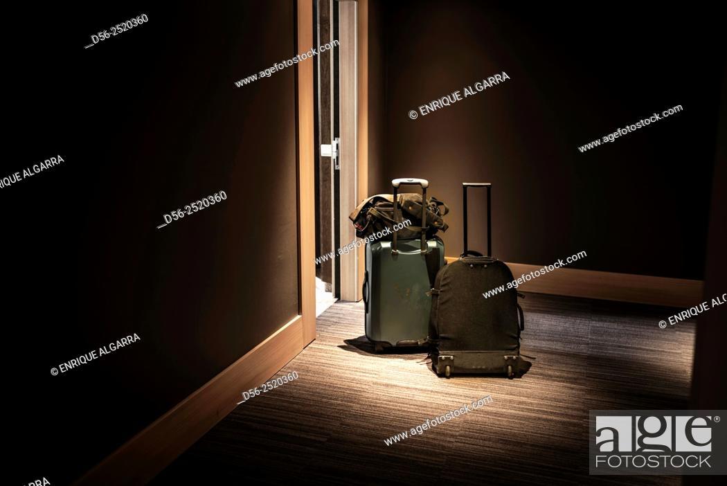 Stock Photo: Luggage in a corridor hotel, Bruges, Belgium.