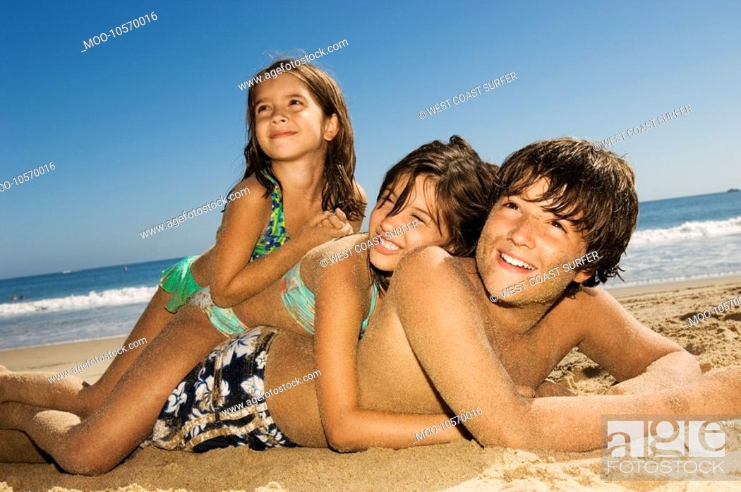 Stock Photo: Children in swimwear playing beach.