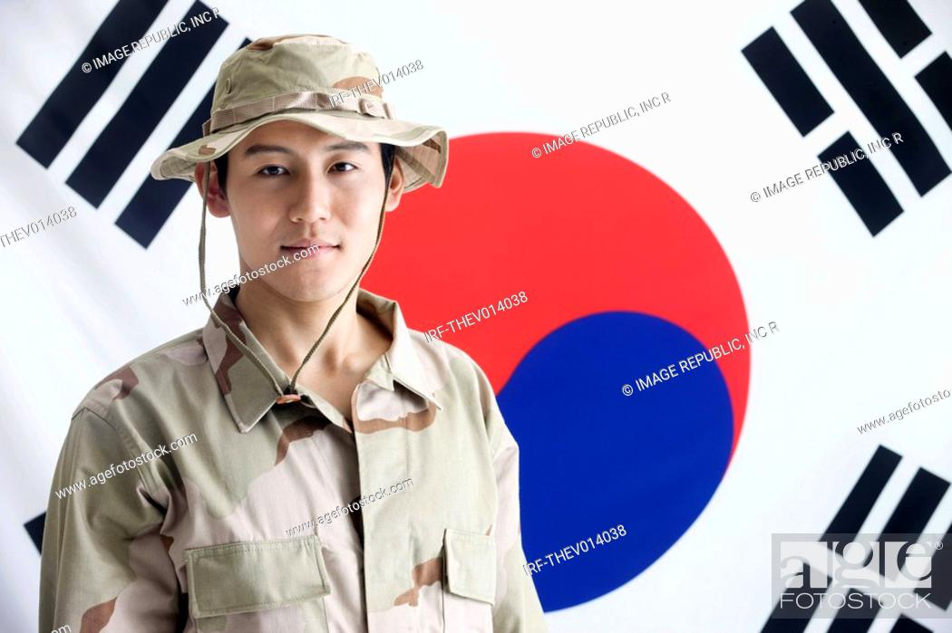 Stock Photo: explorer in front of Korean flag, Taegeukgi.