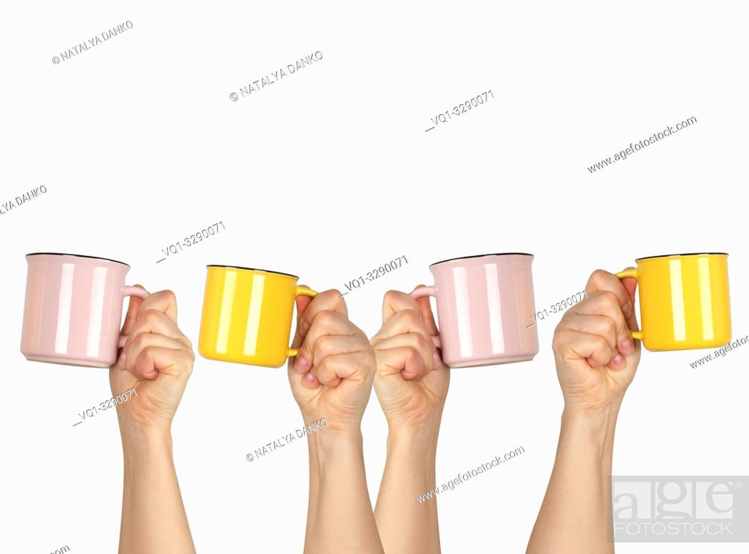 Stock Photo: many raised hands up with ceramic cups on a white background, recruitment concept.