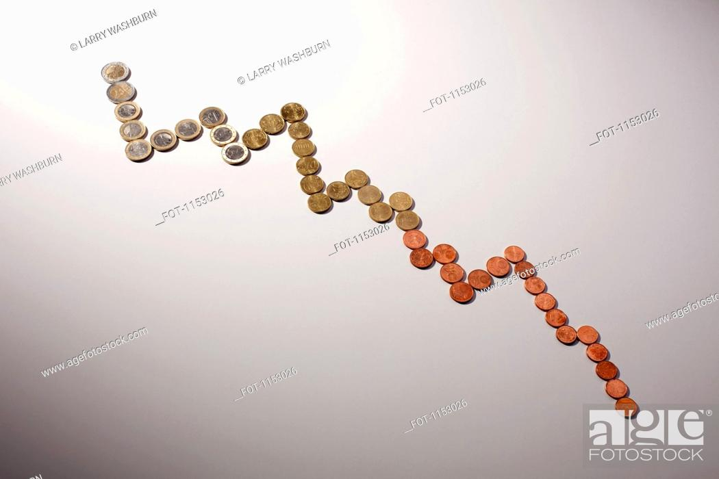 Stock Photo: European Union coins arranged in a decreasing line graph.