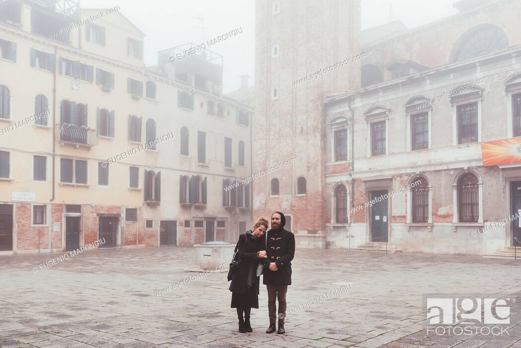 Stock Photo: Portrait of couple in misty square, Venice, Italy.