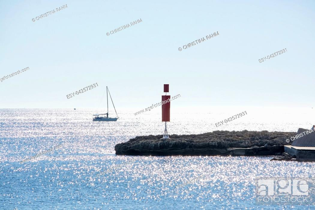 Stock Photo: Sailboat and pier with inlet on a bright sunny day in December in Mallorca, Spain.