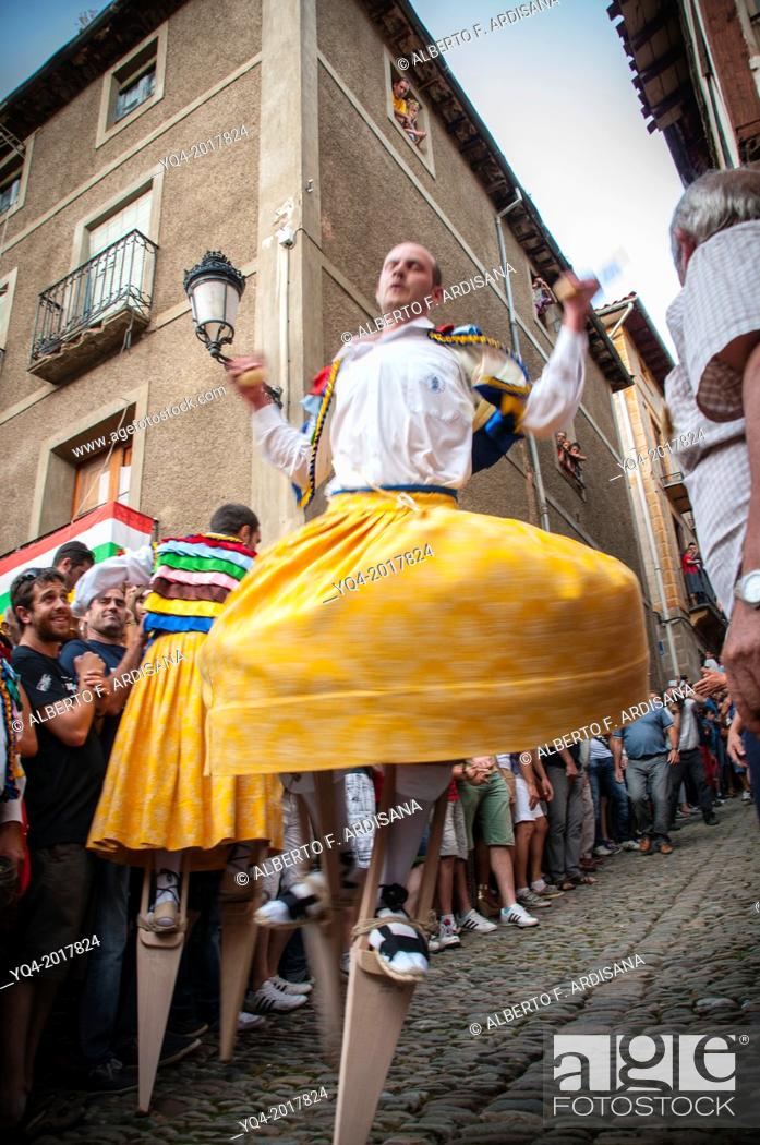 Stock Photo: Down on stilts through the Cuesta of the dancers during the festival of the Madeleine in Anguiano, La Rioja, Spain.