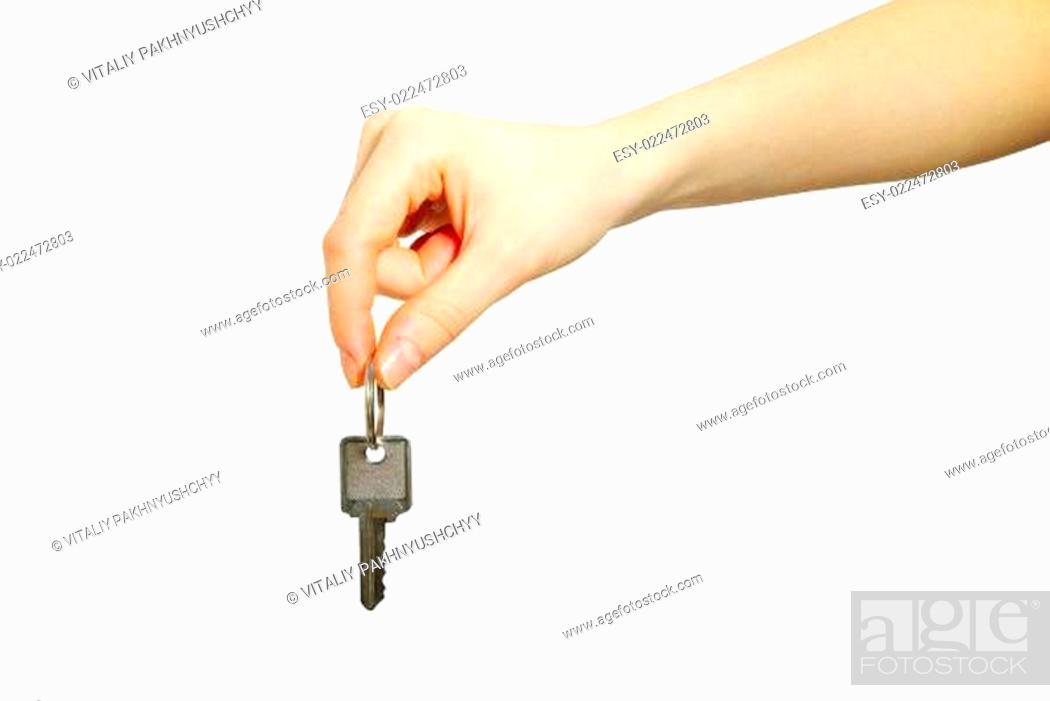 Stock Photo: key in hand.