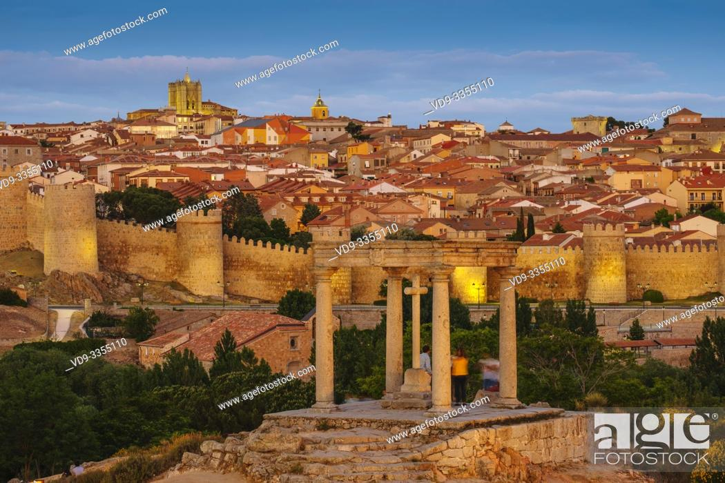 Stock Photo: Medieval monumental walls and the four posts monument at sunset, UNESCO World Heritage Site. Avila city. Castilla León, Spain Europe.