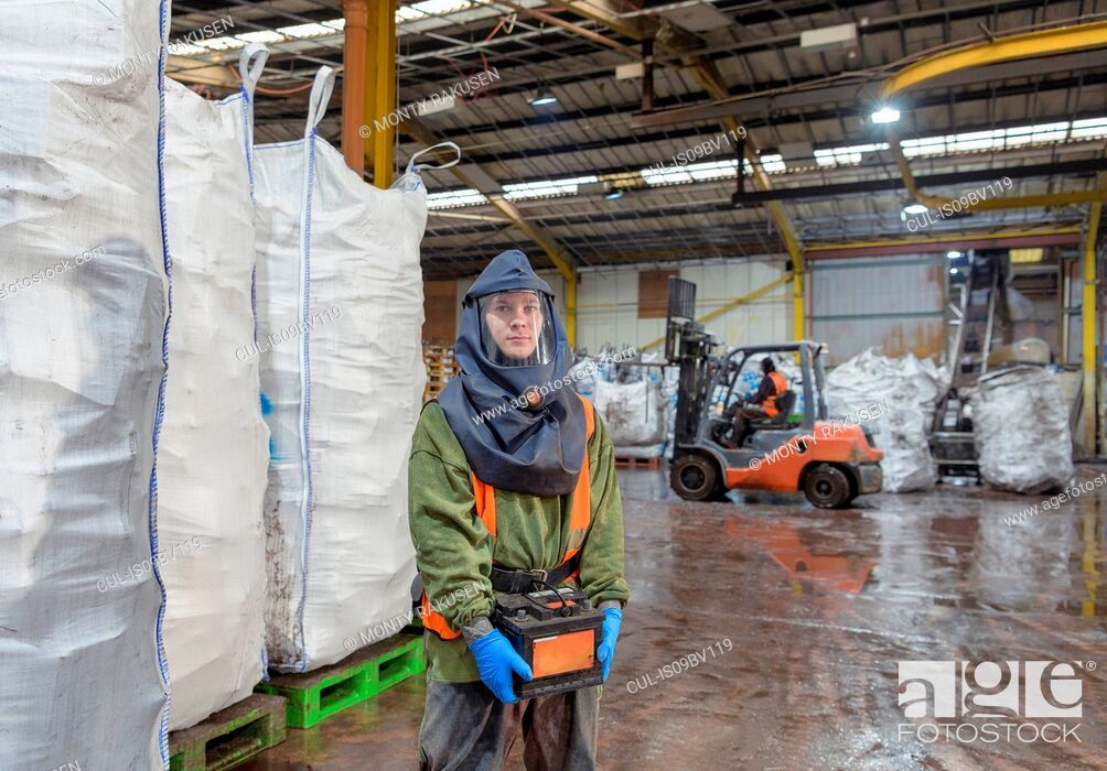 Stock Photo: Portrait of worker in vehicle battery recycling plant.