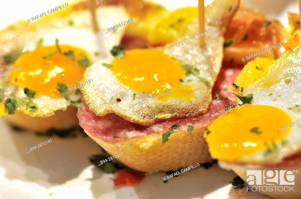 Stock Photo: Fried eggs. Pintxos or Tapas. Food very Typical in the Basque country. San Sebastián (Donostia), Gipuzkoa, Basque Country, Spain.